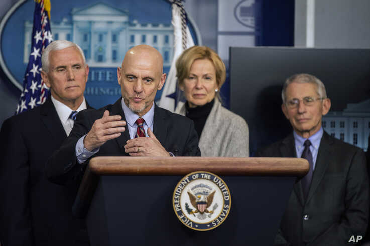 U.S. Food and Drug Administration Commissioner Stephen Hahn, with, from left, Vice President Mike Pence, White House…