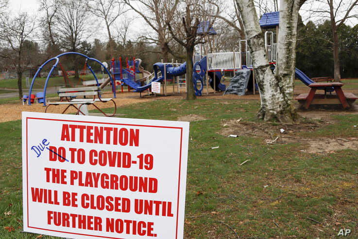 A sign with corrected spelling, tells visitors the playground at the Community Park is closed until further notice due to COVID…