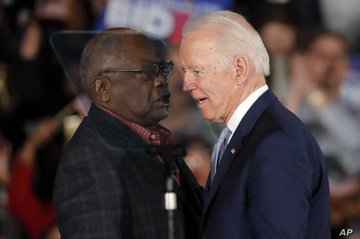 Democratic presidential candidate former Vice President Joe Biden talks to Rep. James Clyburn, D-S.C., at a primary night…