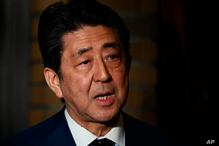 Japan's Prime Minister Shinzo Abe talks to the journalists in front of the prime minister's residence in Tokyo, Tuesday, March…