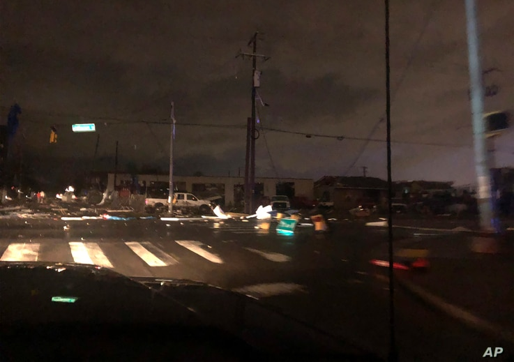 Debris scattered across an intersection Tuesday, March 3, 2020, in downtown Nashville, Tenn. The National Weather Service in…
