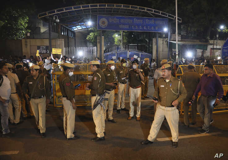 Policemen stand guard at the entrance of Tihar central prison where four men were sentenced to capital punishment in New Delhi,…