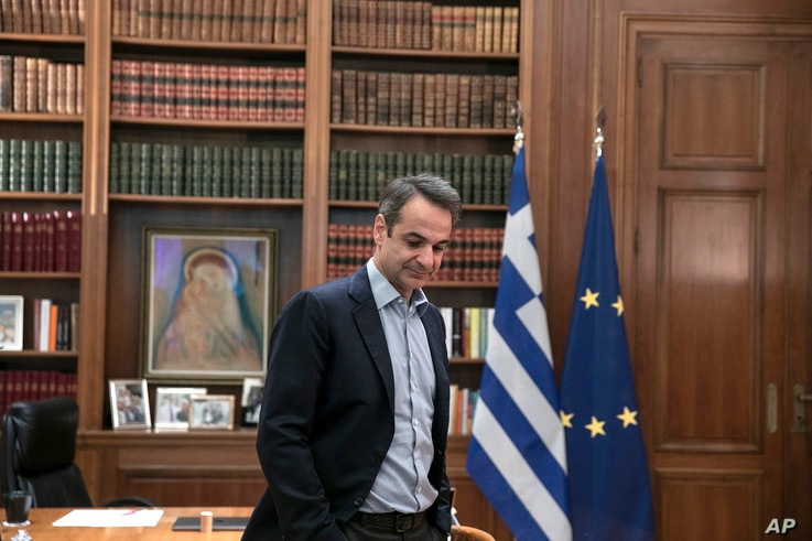 Greece's Prime Minister Kyriakos Mitsotakis, waits for a meeting with Klaus Regling, Managing Director of EMS (European…