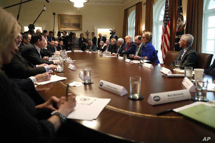 President Donald Trump and Vice President Mike Pence, accompanied by members of the coronavirus task force, meet with…