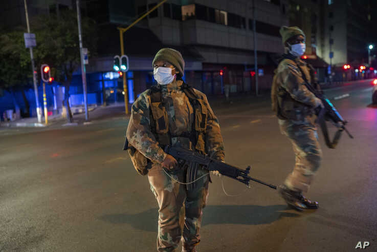 South African Defense Forces patrol downtown Johannesburg, South Africa, Friday, March 27, 2020. Police and army started…
