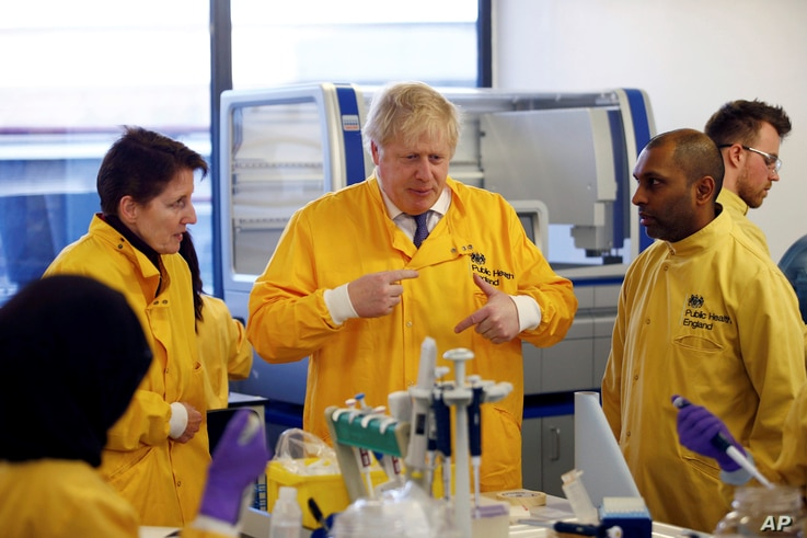 Britain's Prime Minister Boris Johnson visits a laboratory at the Public Health England National Infection Service, after more…