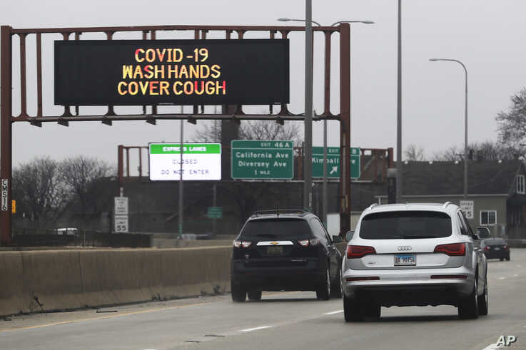 A traffic message board displays a message about coronavirus prevention on I-94 South bound in Chicago, Saturday, March 28,…