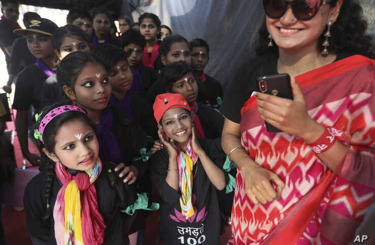 """Children get ready for a play for awareness of violence against women and children during the """"One Billion Rising Campaign""""…"""