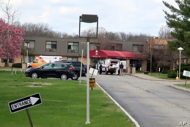 Ambulance crews are parked outside Andover Subacute and Rehabilitation Center in Andover, N.J., on Thursday April 16, 2020.  …