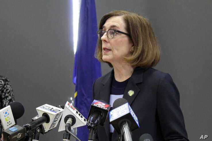 FILE - In this March 16, 2020, file photo, Gov. Kate Brown speaks at a news conference to announce a four-week ban on eat-in…