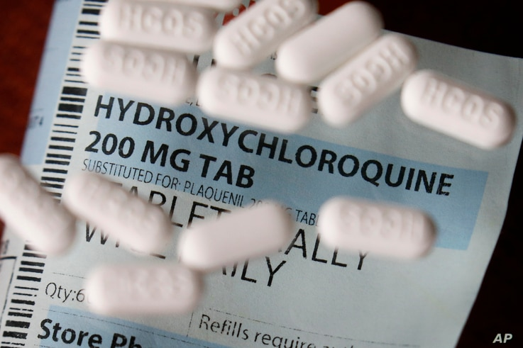 FILE - This Monday, April 6, 2020, file photo shows an arrangement of Hydroxychloroquine pills in Las Vegas. At least 13 states…