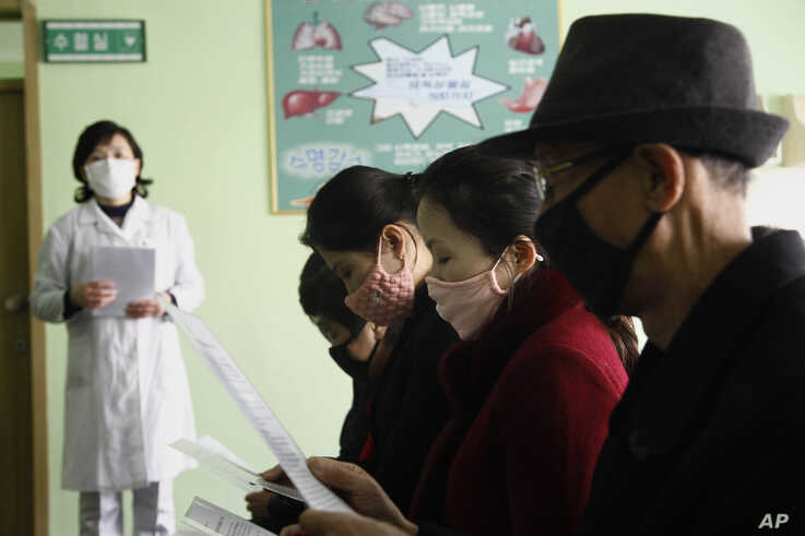 People review information explaining the COVID-19 coronavirus at the Phyongchon District People's Hospital in Pyongyang, North…