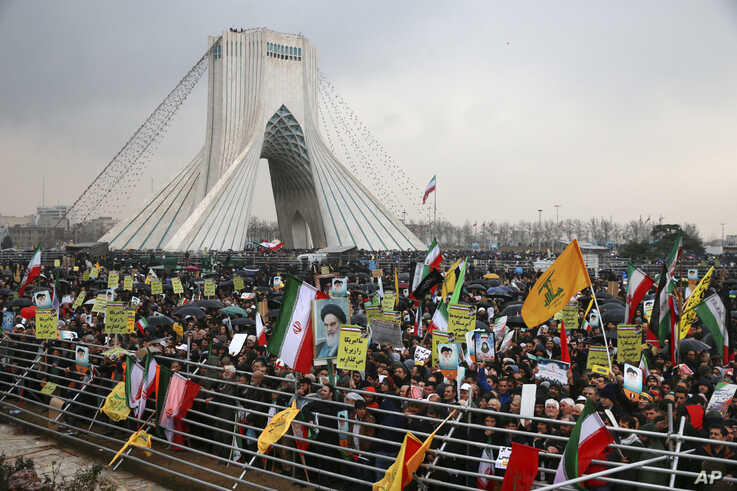 Iranians attend a ceremony celebrating the 40th anniversary of the Islamic Revolution, at the Azadi, or Freedom Tower, in…