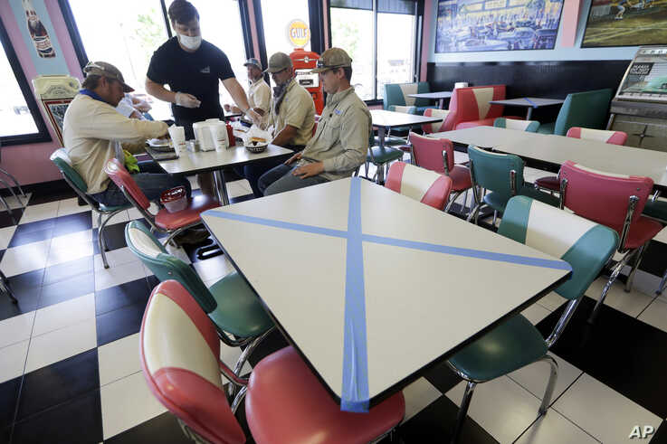 Tables are marked off for social distancing at Hwy 55 Burgers Shakes & Fries Monday, April 27, 2020, in Nolensville, Tenn…
