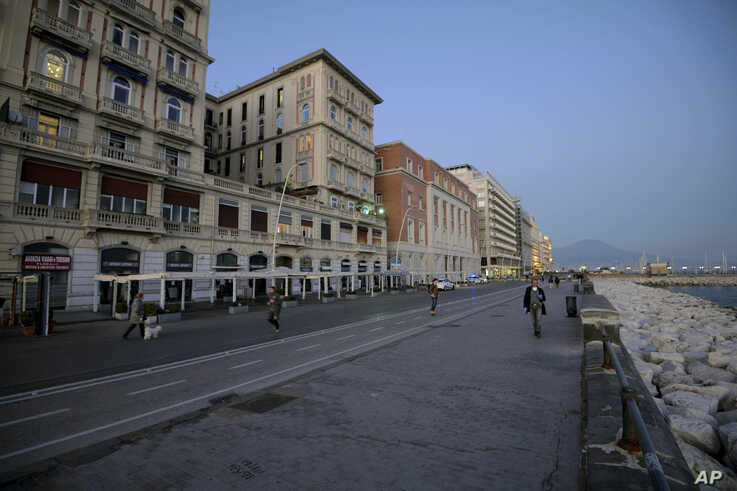 A street is almost empty in downtown Naples, southern Italy, Wednesday, March 11, 2020. In Italy the government extended a…