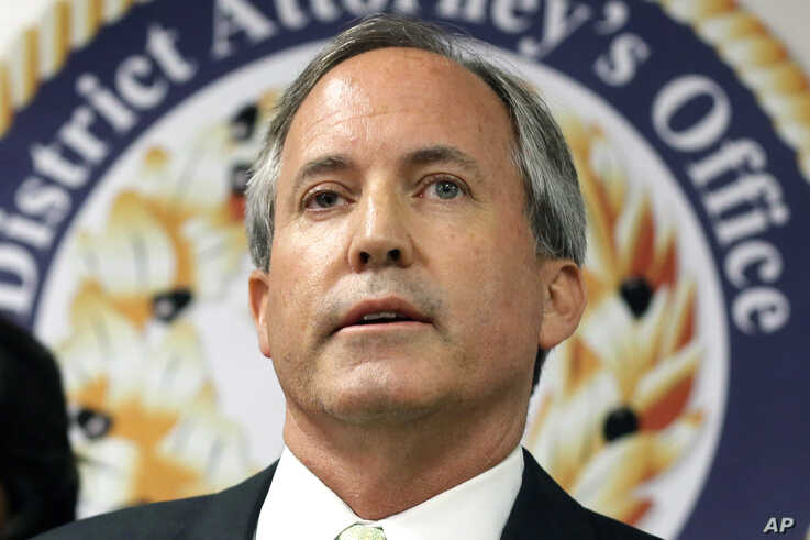 FILE - In this June 22, 2017, file photo, Texas Attorney General Ken Paxton speaks at a news conference in Dallas. Paxton on…
