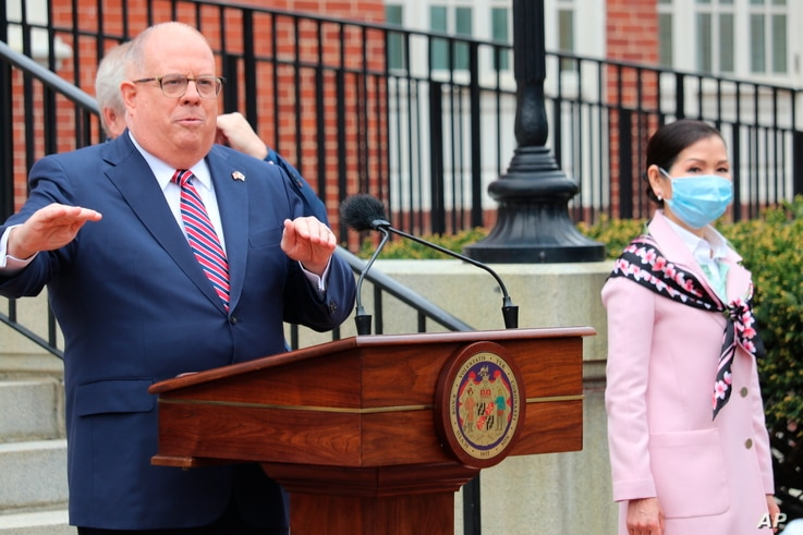 Maryland Gov. Larry Hogan speaks at a news conference on Monday, April 20, 2020 in Annapolis, Md., with his wife, Yumi Hogan,…
