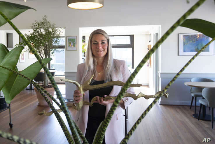 FILE - In this photo taken on Friday, April 24, 2020, Femke Zimmerman, manager of Brasserie Berlage, a cafe and restaurant…