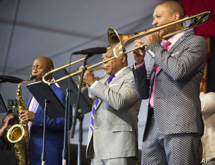 Branford Marsalis, Wynton Marsalis and Delfeayo Marsalis perform in the Ellis Marsalis Family Tribute in the Jazz Tent during…