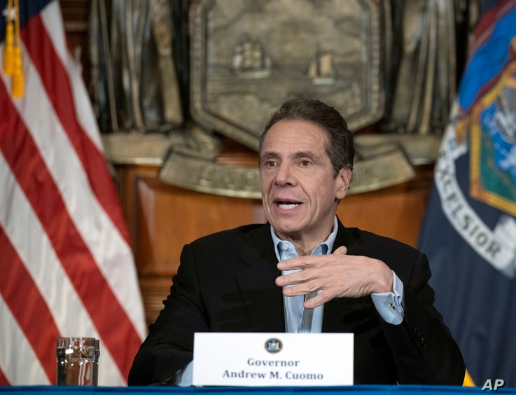 In this April 18, 2020 photo provided by the Office of Governor Andrew M. Cuomo, Gov. Cuomo provides a coronavirus update…