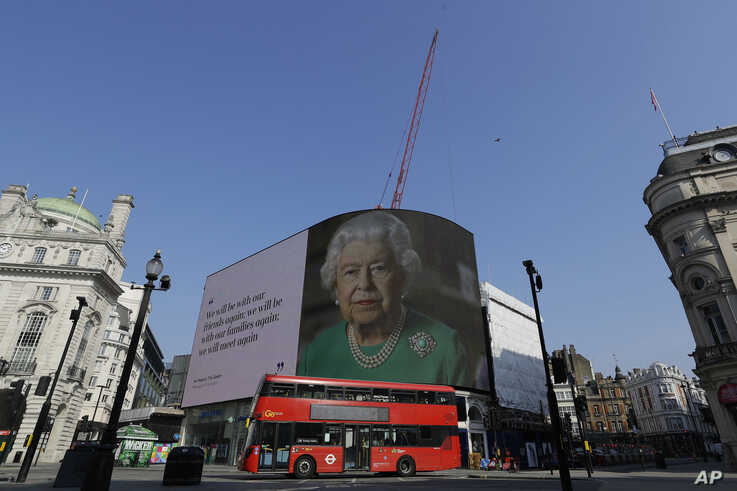 An image of Britain's Queen Elizabeth II and quotes from her historic television broadcast commenting on the coronavirus…