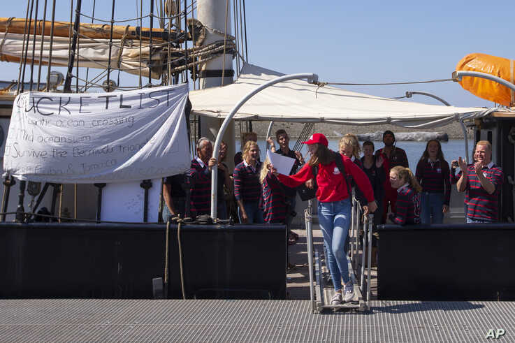 Aukje Wakkerman is the last to disembark from the Wylde Swan schooner carrying 25 Dutch teens who sailed home from the…
