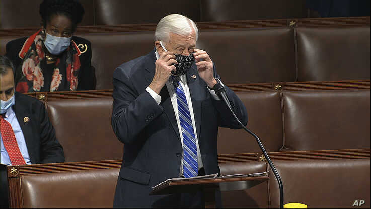 In this image from video, Rep. Steny Hoyer, D-Md., takes his face covering off as he speaks on the floor of the House of…
