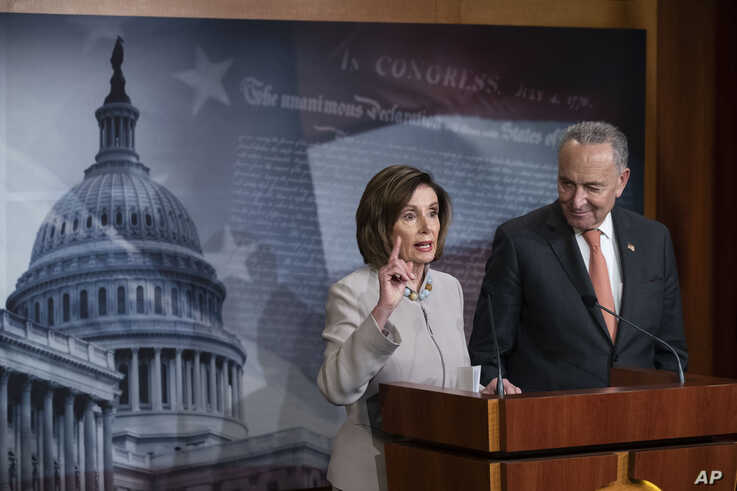 House Speaker Nancy Pelosi of Calif., joined by Senate Minority Leader Chuck Schumer of N.Y., speaks during a news conference,…
