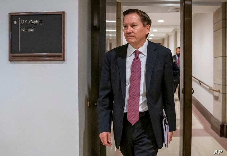 FILE - In this Oct. 4, 2019, file photo, Michael Atkinson, the inspector general of the intelligence community, arrives at the…