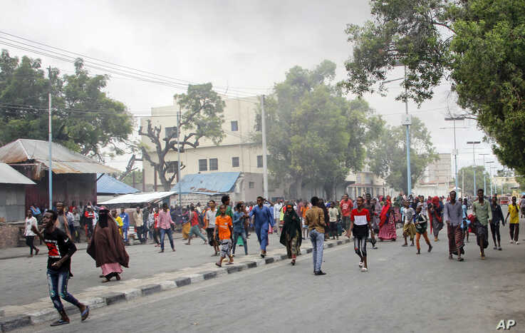 Somalis protest against the killing Friday night of at least one civilian during the overnight curfew, which is intended to…