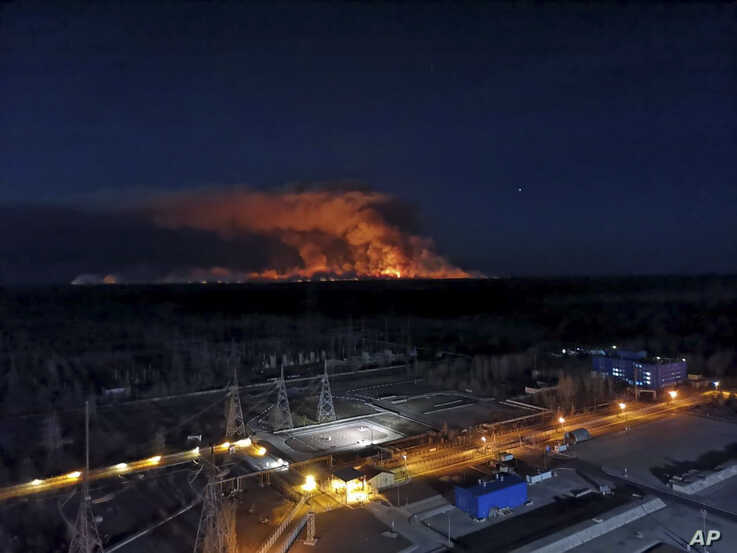 In this photo taken from the roof of Ukraine's Chernobyl nuclear power plant late Friday April 10, 2020, a forest fire is seen…