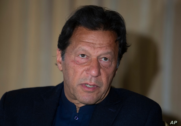 Pakistan's Prime Minister Imran Khan speaks to The Associated Press, in Islamabad, Pakistan, Monday, March 16, 2020. Khan said…