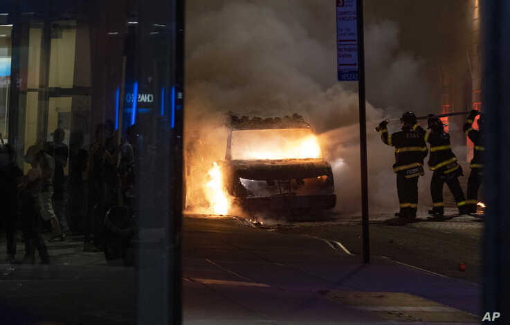 A vehicle burns near New York's Union Square Saturday, May 30, 2020, as police confronted protesters in the death of George…