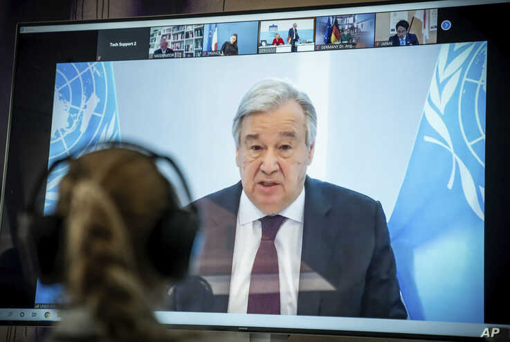 Antonio Guterres, UN Secretary-General displayed on a screen at the  Environment Ministry as he delivers his speech at the…