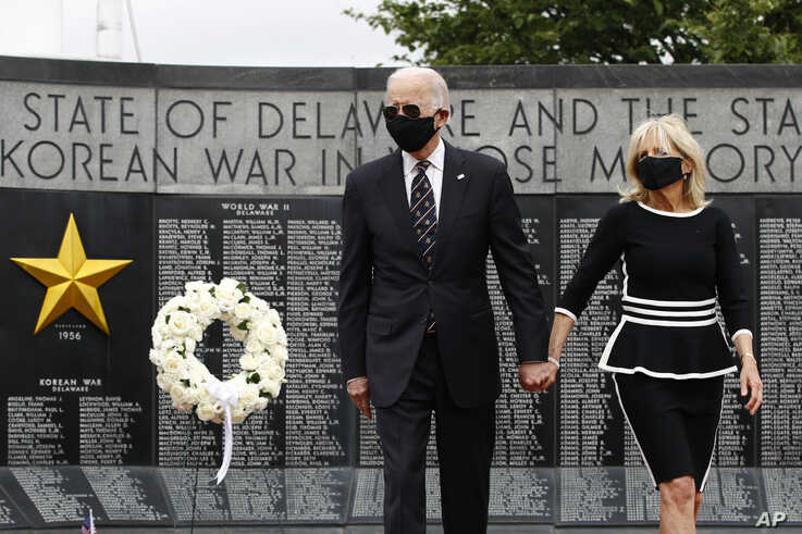 Democratic presidential candidate, former Vice President Joe Biden and Jill Biden depart after placing a wreath at the Delaware…