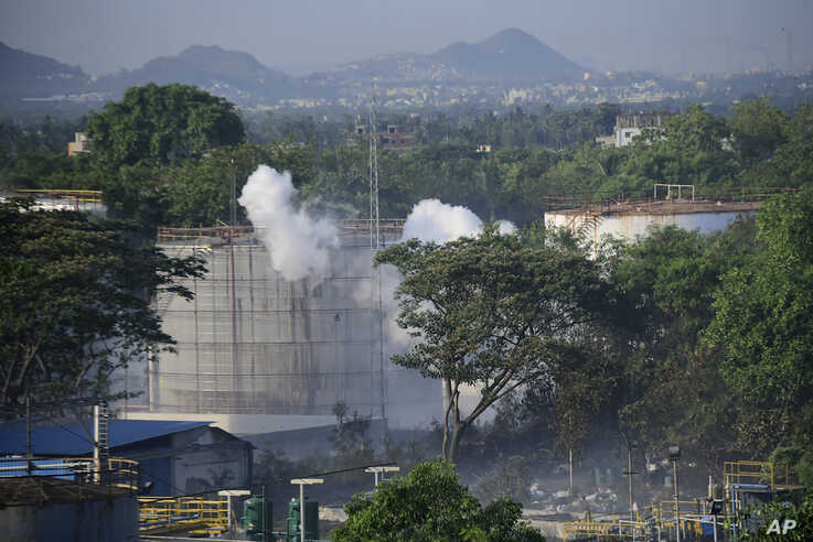 Smoke rises from LG Polymers plant, the site of a chemical gas leakage, in Vishakhapatnam, India, Thursday, May 7, 2020…