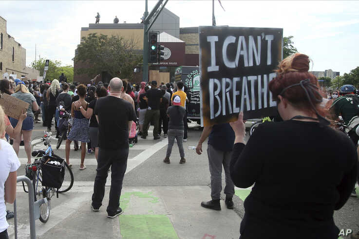Demonstrators protest at the Third Precinct Wednesday, May 27, 2020 as people protest the arrest and death of George Floyd who…