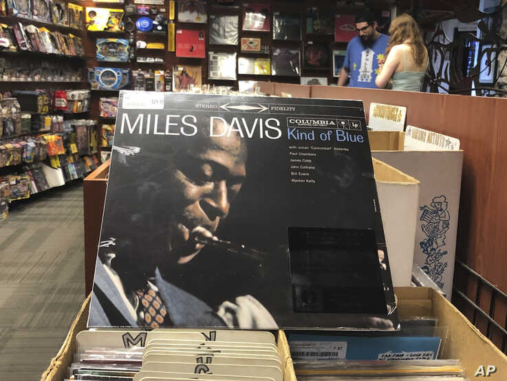"FILE - In this Aug. 17, 2019, file photo, the ""Kind of Blue"" album cover is on display at Bull Moose record store in Portland,…"