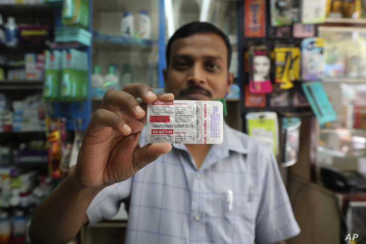 A chemist displays hydroxychloroquine tablets in Mumbai, India, Tuesday, May 19, 2020. President Donald Trump's declaration…