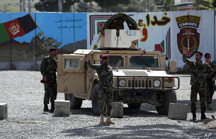 Afghan special forces stand guard near the site of a suicide bomber attack on the outskirts of Kabul, Afghanistan, Wednesday,…