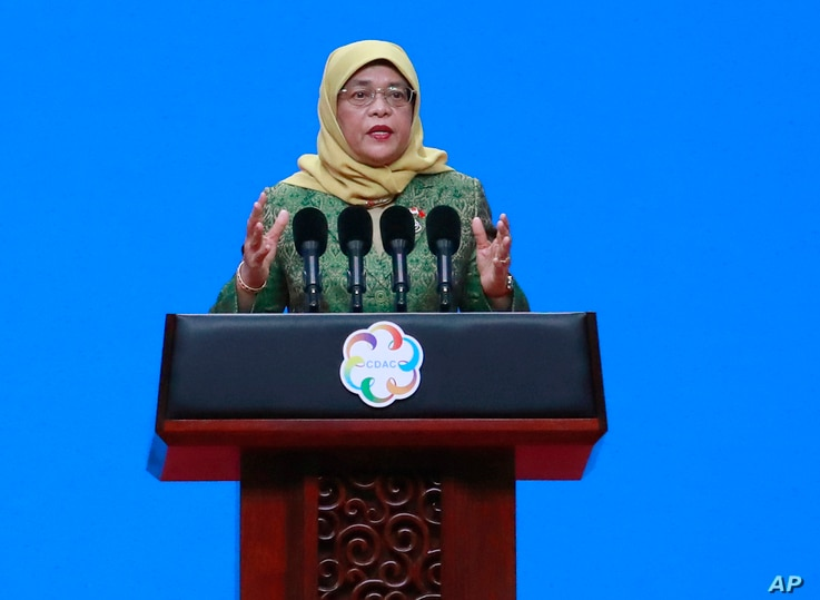 Singapore's President Halimah Yacob delivers a speech during the opening ceremony of the Conference on Dialogue of Asian…