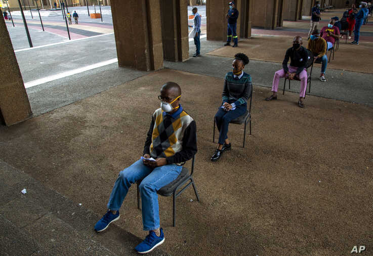 Off duty metro police officers queue to be screened and tested for COVID-19 in Johannesburg, South Africa, Thursday, May 7,…