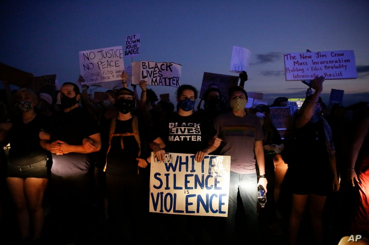 Protesters block traffic on the highway during protests Saturday, June 13, 2020, near the Atlanta Wendy's where Rayshard Brooks...