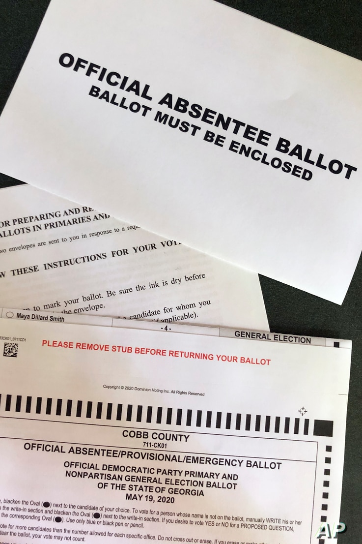 A Cobb County Ga., absentee ballot is seen Tuesday, May 5, 2020, in Kennesaw, Ga. Presidential Preference Primary, General…