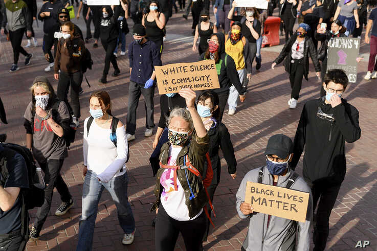 Demonstrators march in San Francisco on Sunday, May 31, 2020, protesting the death of George Floyd, who died after being…