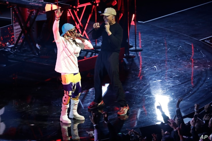 Lil Wayne and Chance the Rapper perform during halftime of the NBA All-Star basketball game Sunday, Feb. 16, 2020, in Chicago. …