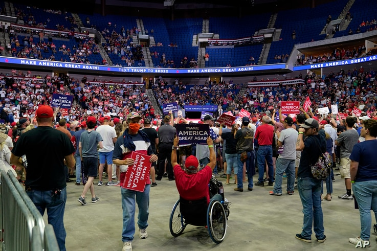 President Donald Trump supporters listen to Trump speak during a campaign rally at the BOK Center, Saturday, June 20, 2020, in…