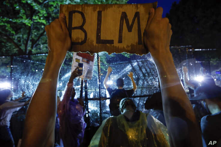 Demonstrators protest Thursday, June 4, 2020, near the White House in Washington, over the death of George Floyd, a black man…