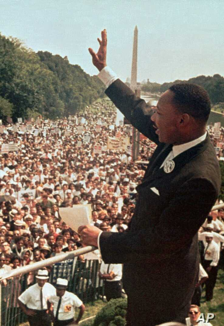 FILE - In this Aug. 28, 1963 file photo, the Rev. Dr. Martin Luther King, Jr. acknowledges the crowd at the Lincoln Memorial…