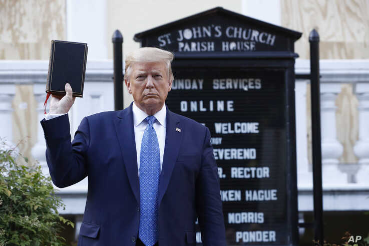 President Donald Trump holds a Bible as he visits outside St. John's Church across Lafayette Park from the White House Monday,…